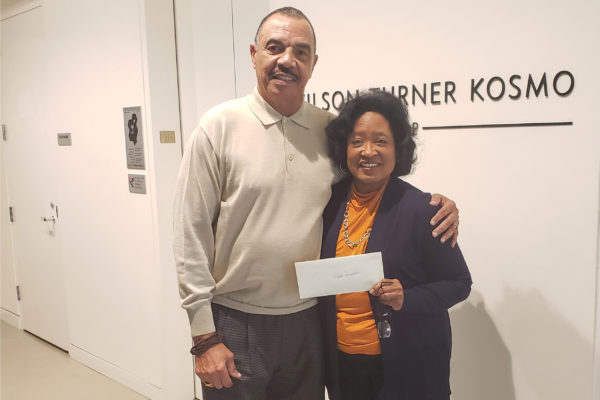 Turner Dream Foundation President Vickie Turner giving a check to the SD Alpha Foundation.